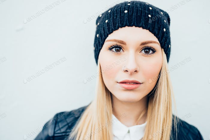 Portrait of young beautiful caucasian blonde hair woman with nos
