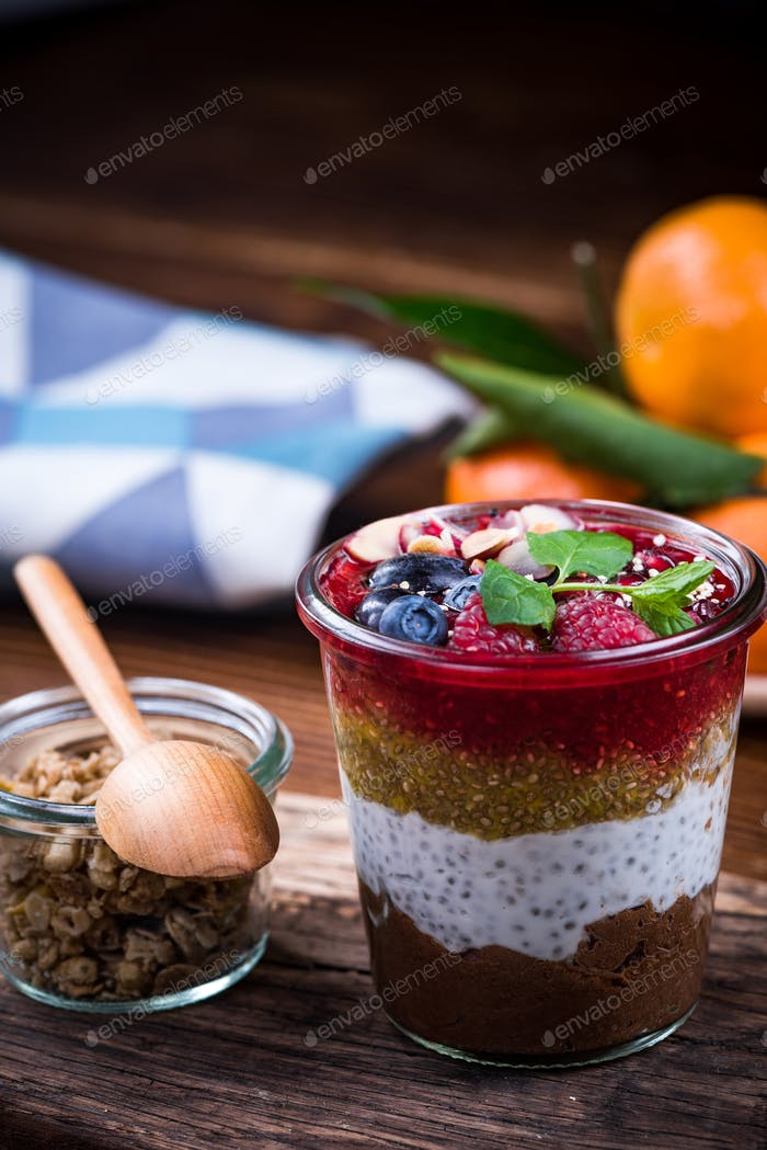 Healthy brunch with fruits and granola, served in jar