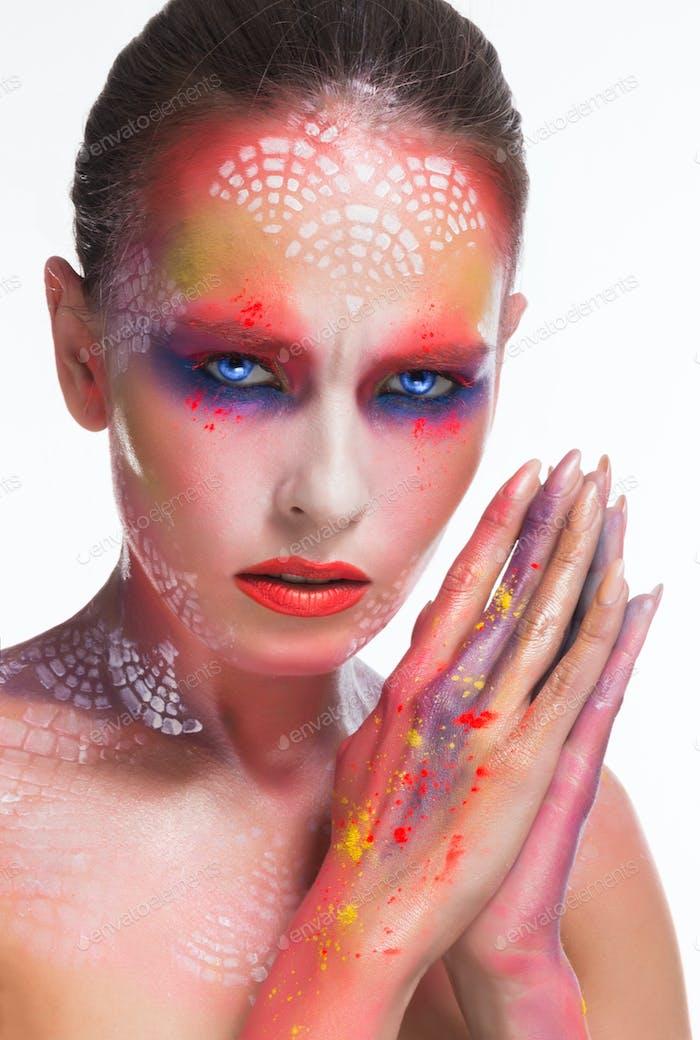 Beauty woman withart makeup and piercing gaze
