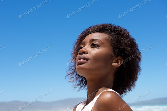 Attractive young african woman outdoors