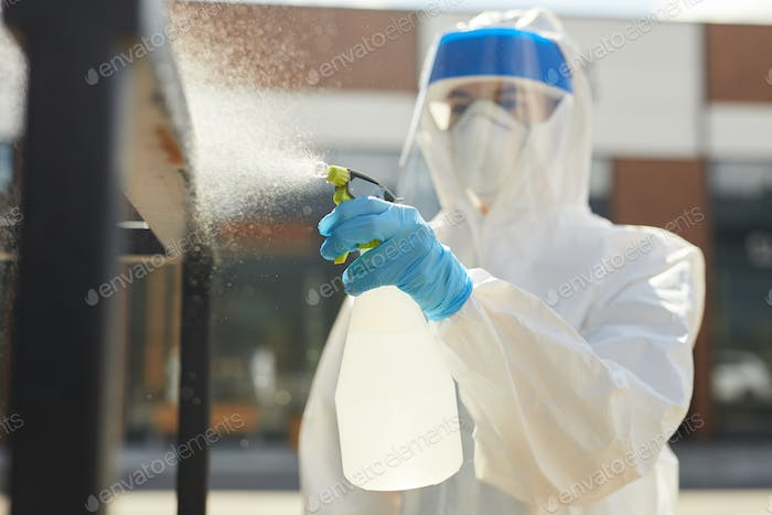 Female Worker Spraying Chemicals