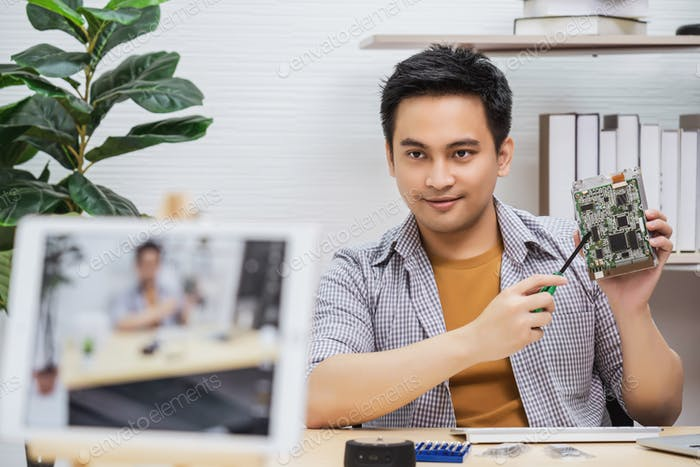 Asian Vlogger man satisfied old technology of hard disk when recommend and sharing knowledge