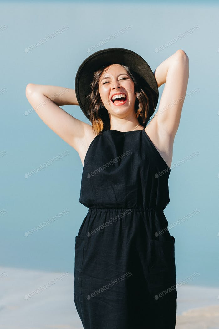 joyous happy girl in a black dress loudly