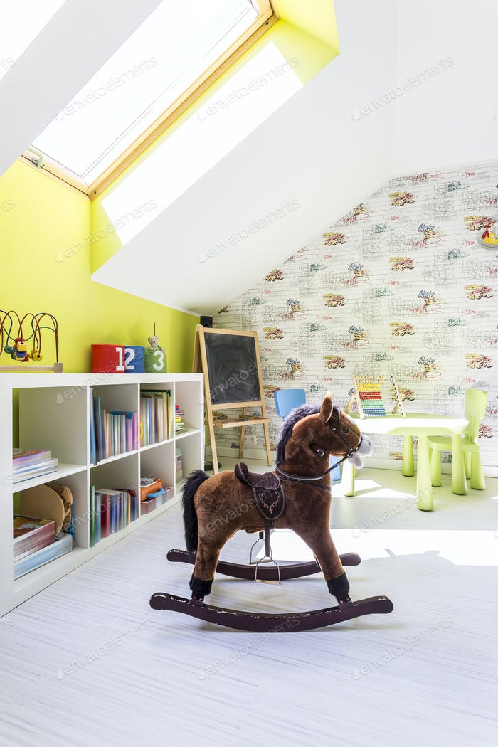 Cute kids room with a rocking horse