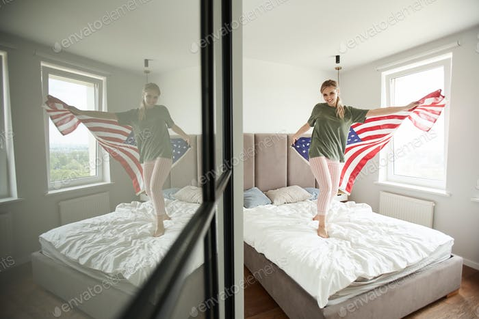 Cheerful patriot with American flag celebrating Independence day