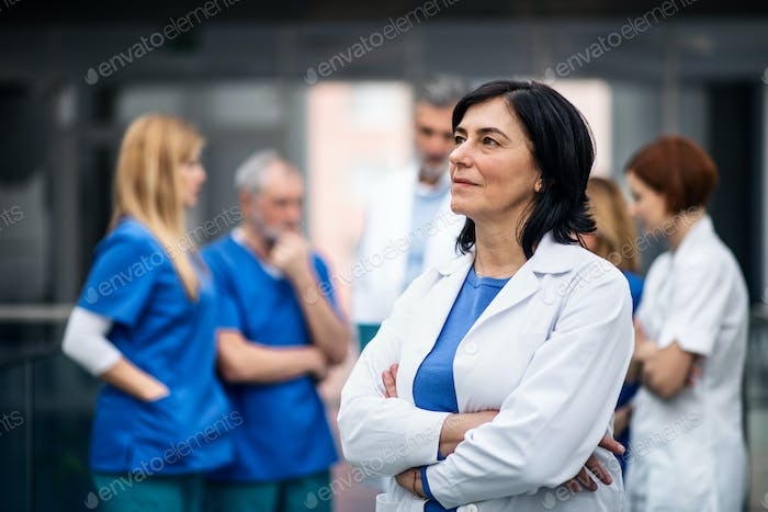 Group of doctors standing in hospital on medical conference