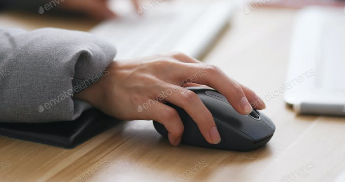 Designer working on computer and drawing pad