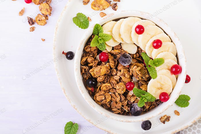 Breakfast. Bowl of homemade granola with yogurt and fresh berries.