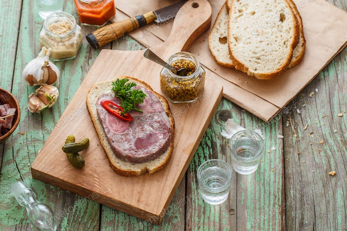 Headcheese sandwich on a cutting board, copy space