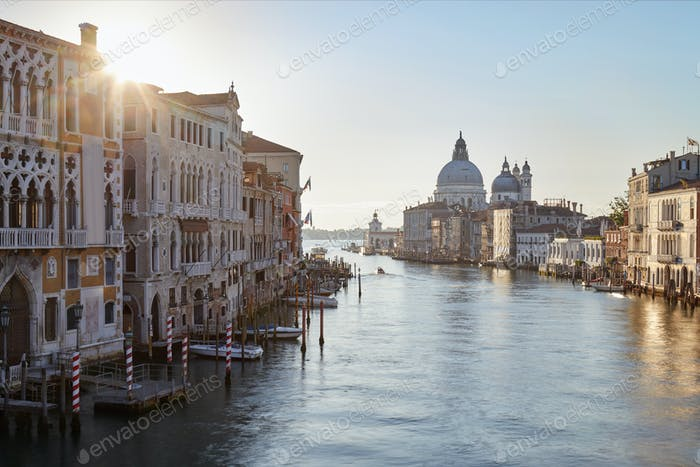 Grand Canal in Venice with Saint Mary of Health basilica, sun in Italy