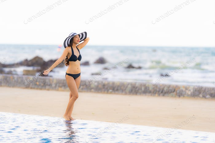 Portrait beautiful young asian woman wear bikini around swimming