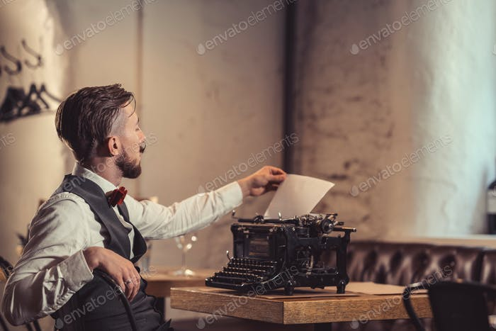 Young writer with a retro typewriter