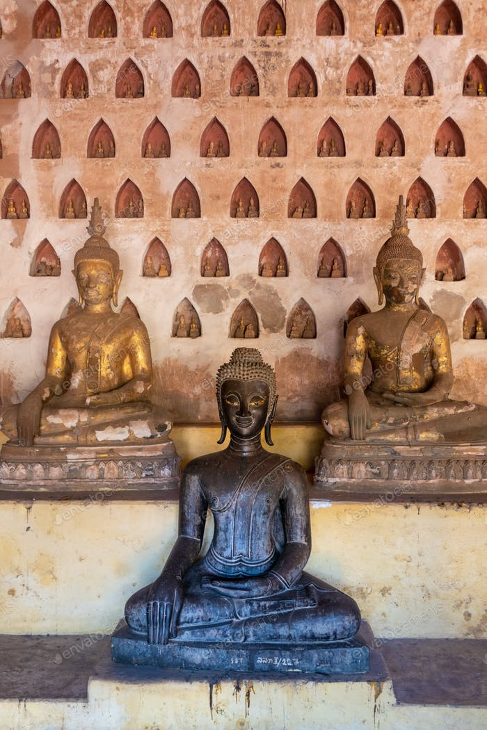 Wat Si Saket, a collection of statues in wall niches,  Vientiane, Laos