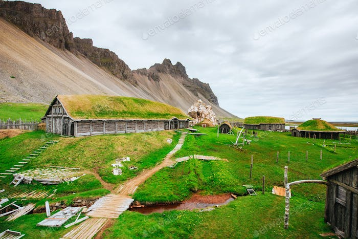 Traditional Viking village. Wooden houses near the mountain firs