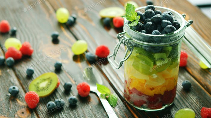 Assortment of fruits in jar