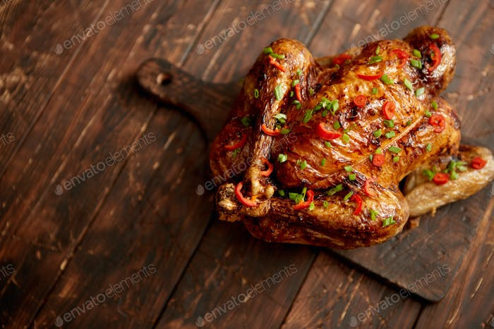 Homemade roasted spicy chicken with chilli and chive