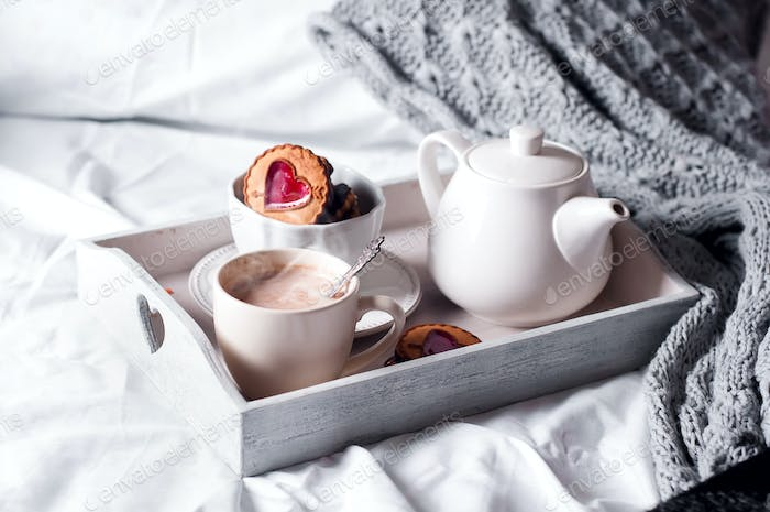 breakfast in bed with coffee and cookies