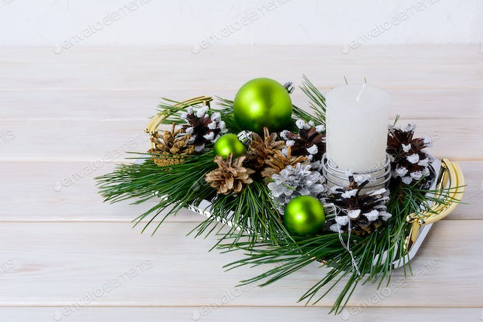 Christmas green ornaments, snowy and silver pinecones
