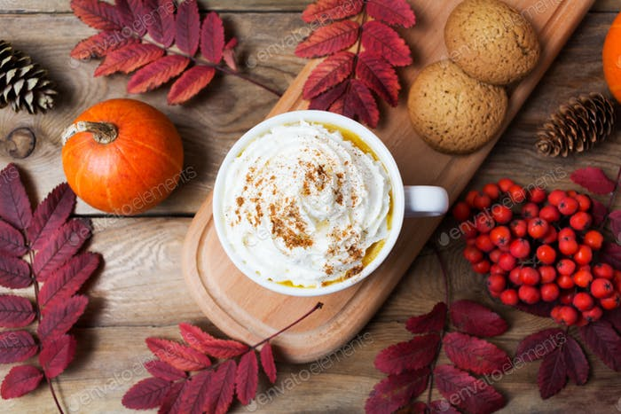 Pumpkin spice latte mug with whipped cream, top view