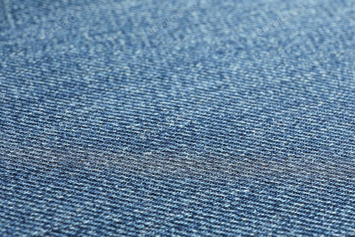 Texture of blue jeans as background, space for text
