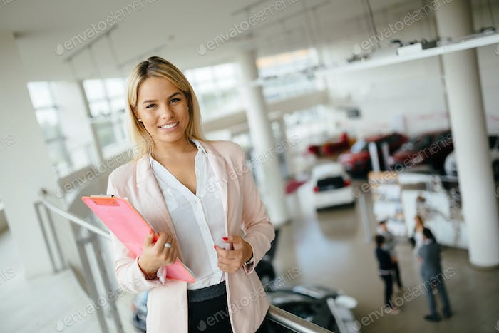 Salesperson workin at car dealership