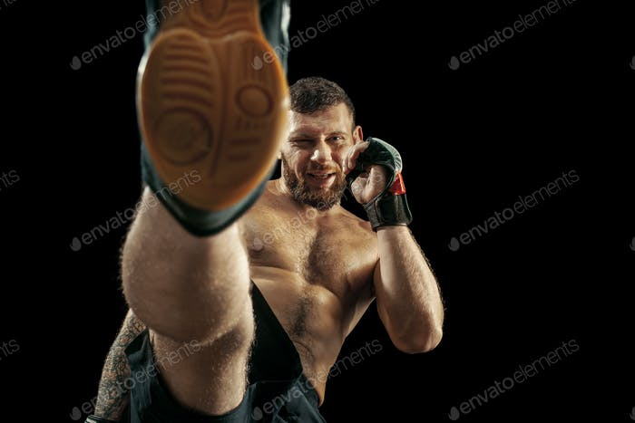 professional boxer boxing isolated on black studio background