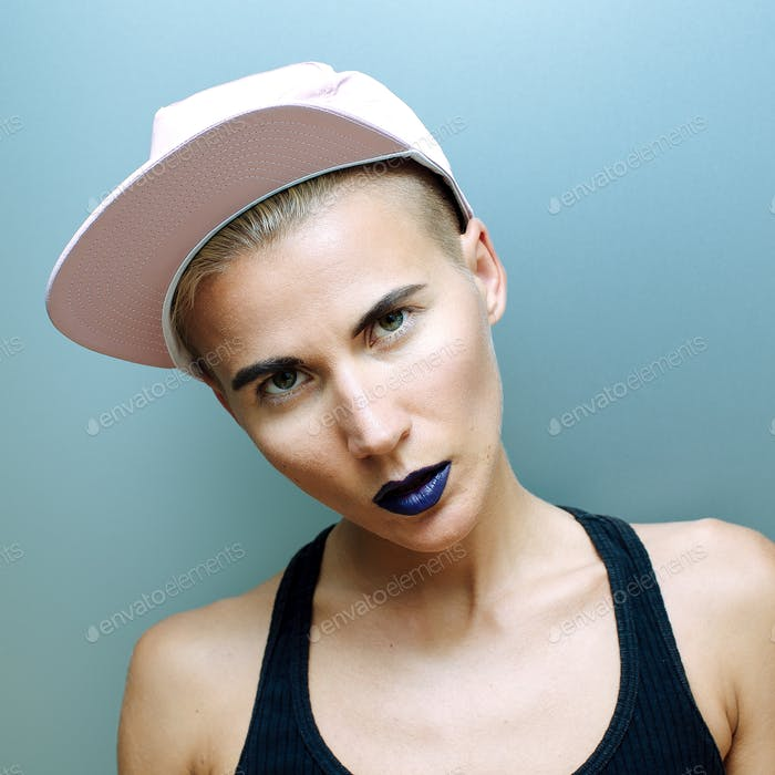 Girl in a cap. Tomboy style fashion
