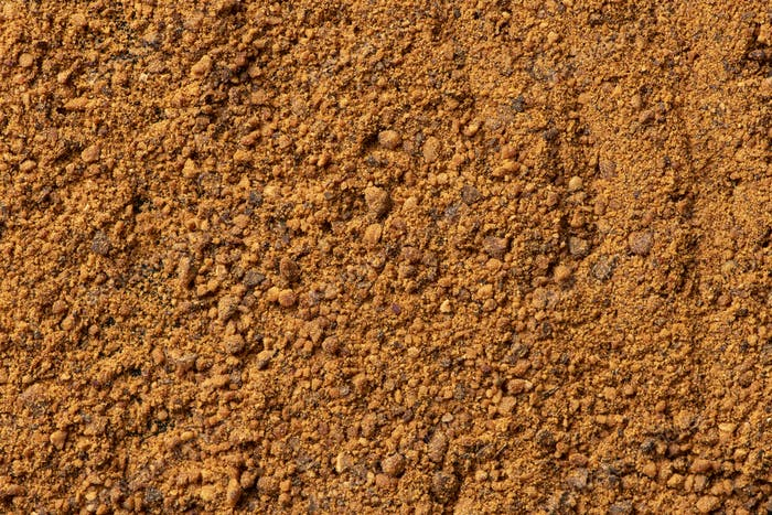 Background texture of nutmeg powder spice