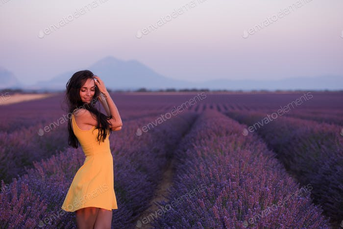 woman in yellow dress at lavender field