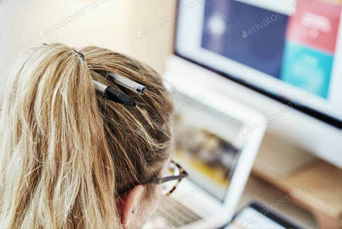 Over the shoulder view, woman at a workstation