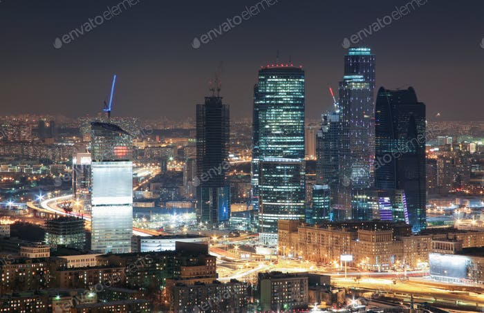 View from the rooftops in the winter on skyscrapers night city