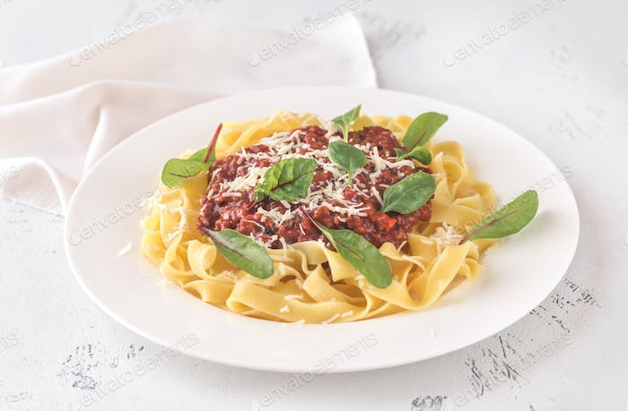 Portion of tagliatelle with bolognese sauce