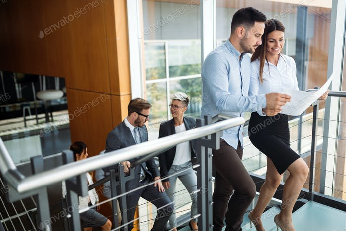 Picture of businessman and businesswoman having discussion