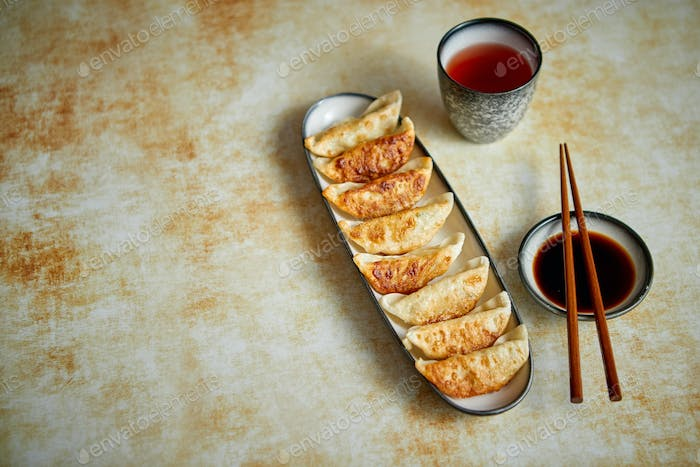 Orginal asian dumplings gyoza served in long plate