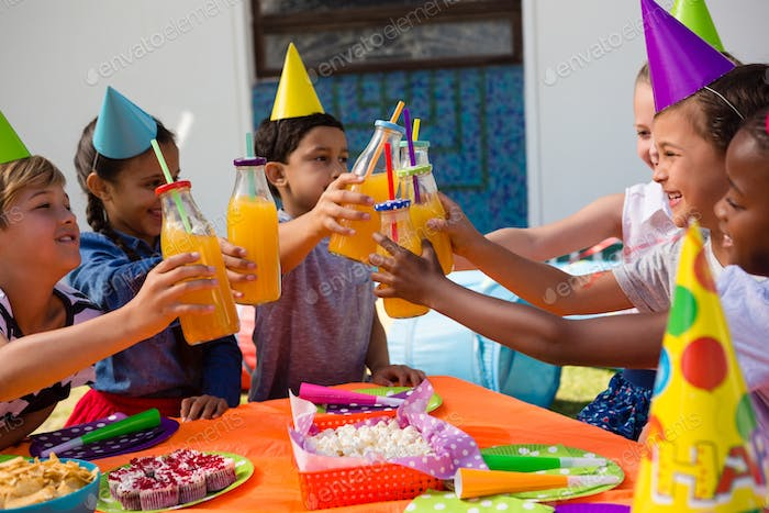 Children toasting drinking bottles
