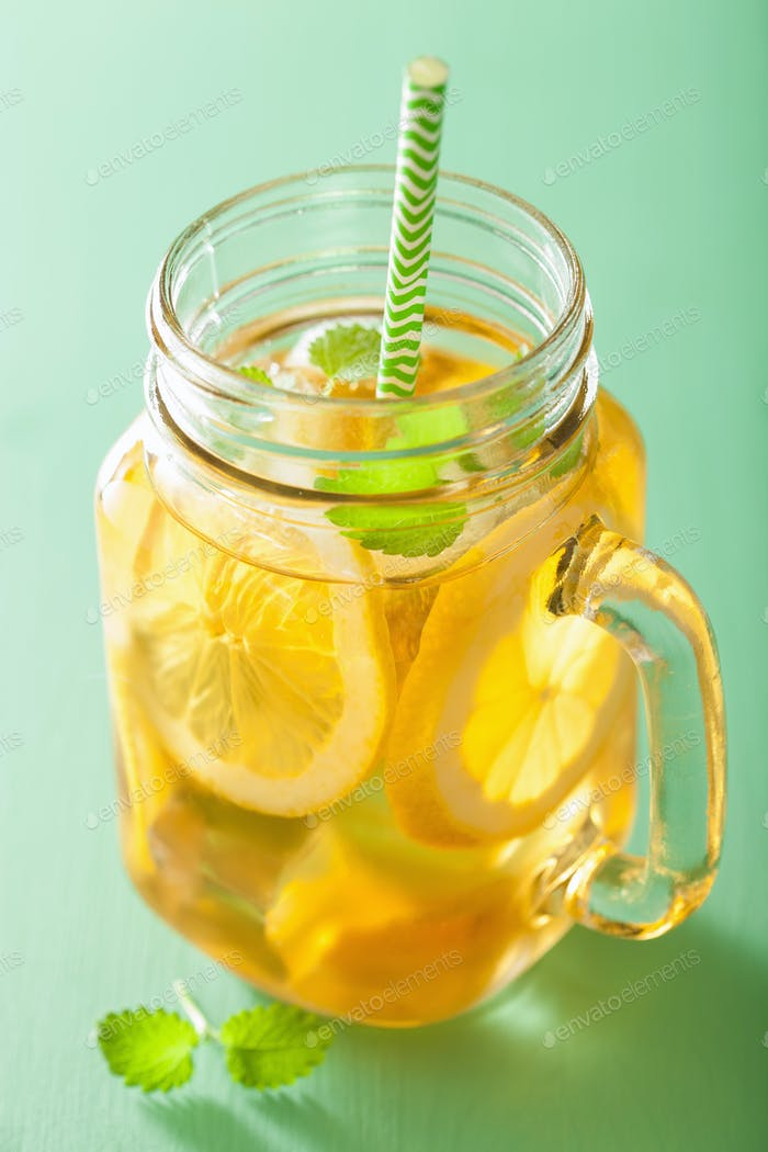 ice tea with lemon and melissa in mason jar