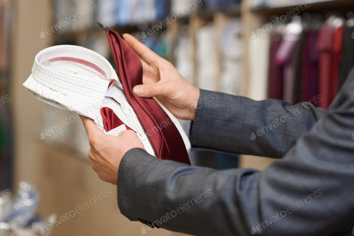 Close up of customer choosing festive clothes for special occaision