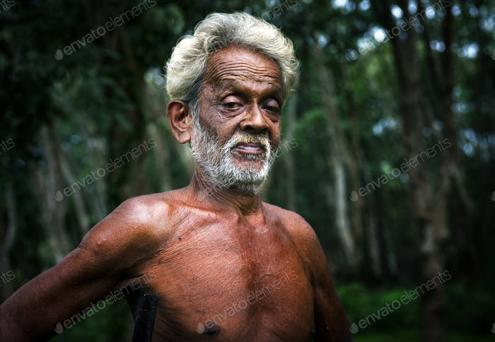 Mature Sri Lankan Man Forest Agriculture Plantation Concept