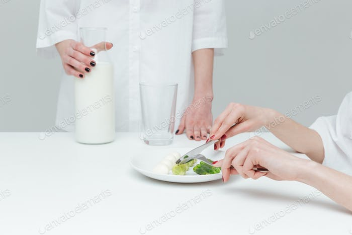 Close-up of hands during lunch at the table