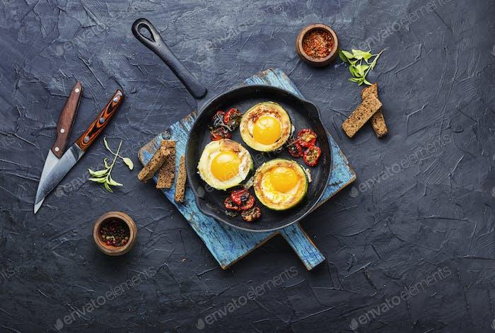 Scrambled eggs on frying pan