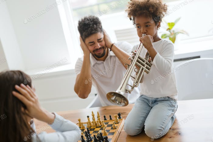 Picture of happy family having fun time together