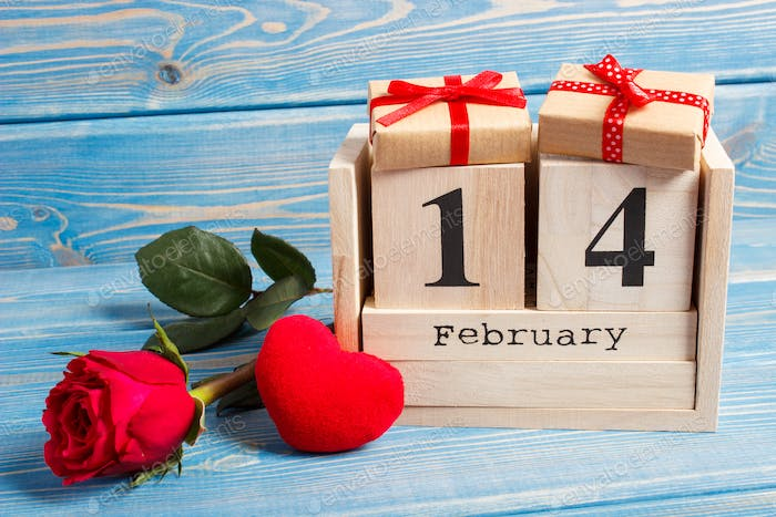 Cube calendar with date 14 February, wrapped gift, red heart and rose flower, Valentines day
