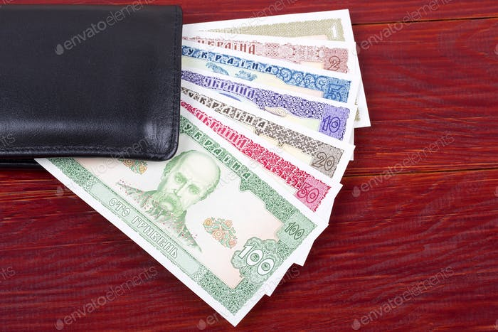 Old Ukrainian money in the black wallet