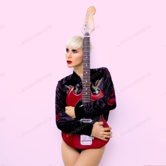 Lady Rock with electro guitar.  Fashion style