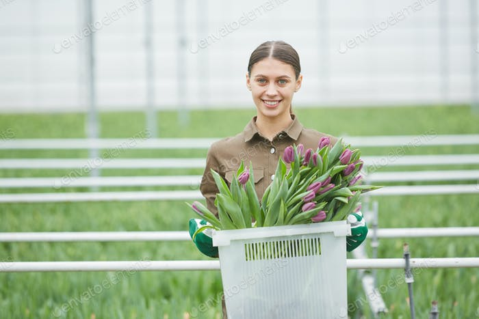 Smiling Woman Carrying Fresh Tulips
