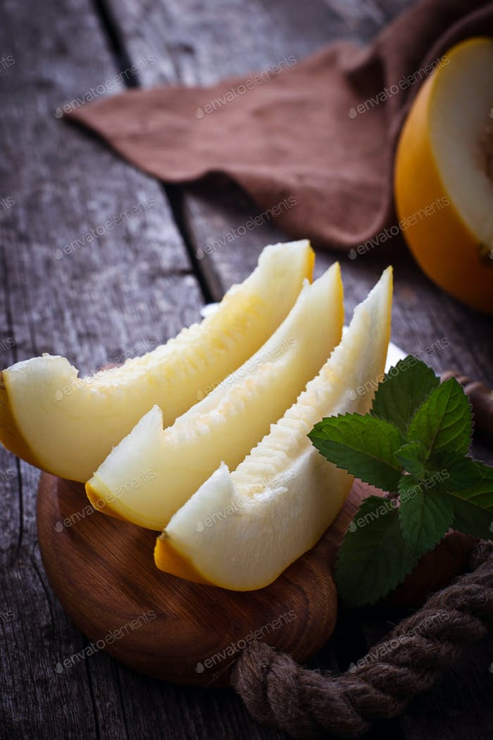 Fresh sweet sliced melon with mint