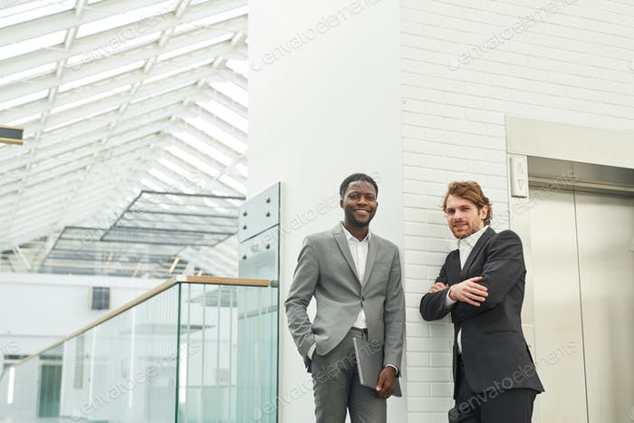 Two Modern Businessmen in Office Building