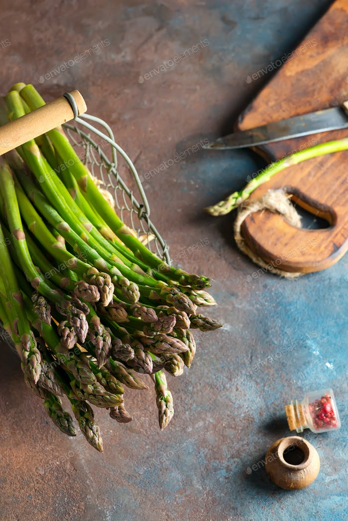 Bundle of fresh home grown organic asparagus vegetable in a basket ready for cooking healthy vegan