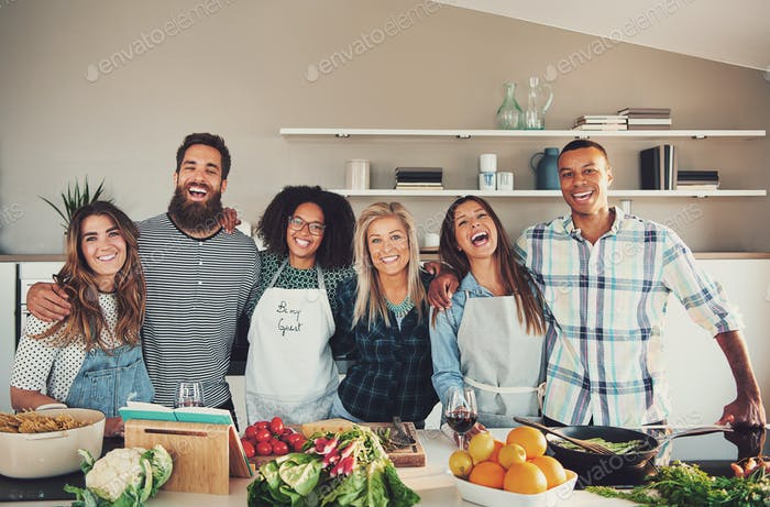 Group of six adults at food preparation table