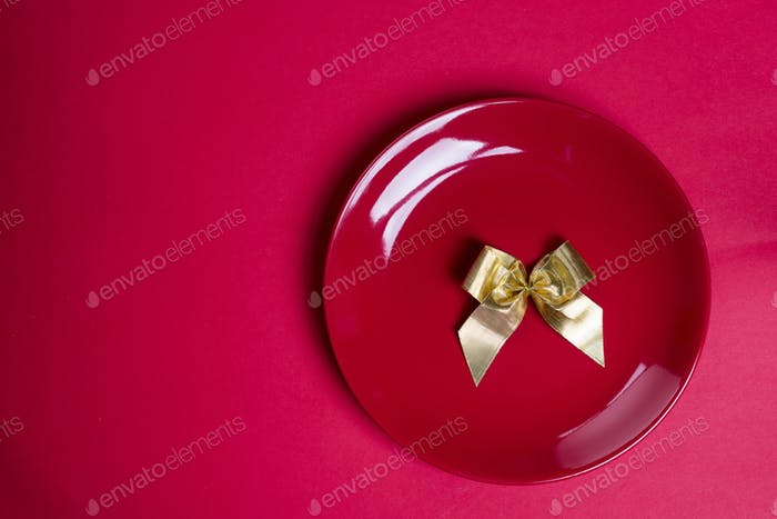 Gold ribbon on red plate.